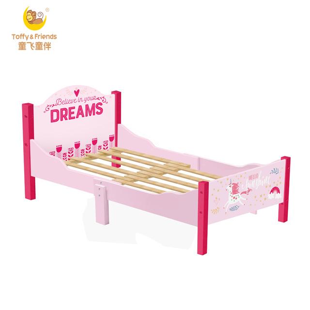 Kids wooden single bed length adjustable in pink unicorn design .