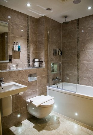 One of our Deluxe bathrooms - featuring new bathroom suites, mood .