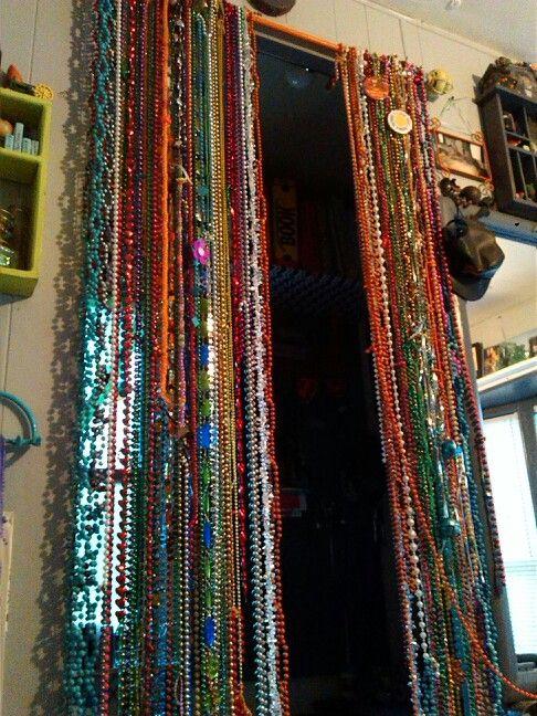 Beaded curtain.diy... Mardi gras beads curtain rod...time, still .