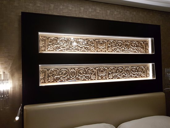 unique design at the headboard of bed - Picture of Kempinski Hotel .