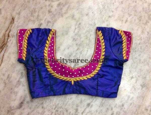 Blue color raw silk designer blouse with fuchsia pink color patch .
