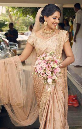 Pretty ivory bridal saree with veil | Kochi weddings | Joseph .