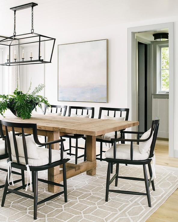 Beige Wood Plank Dining Table with Black Wooden Chairs .