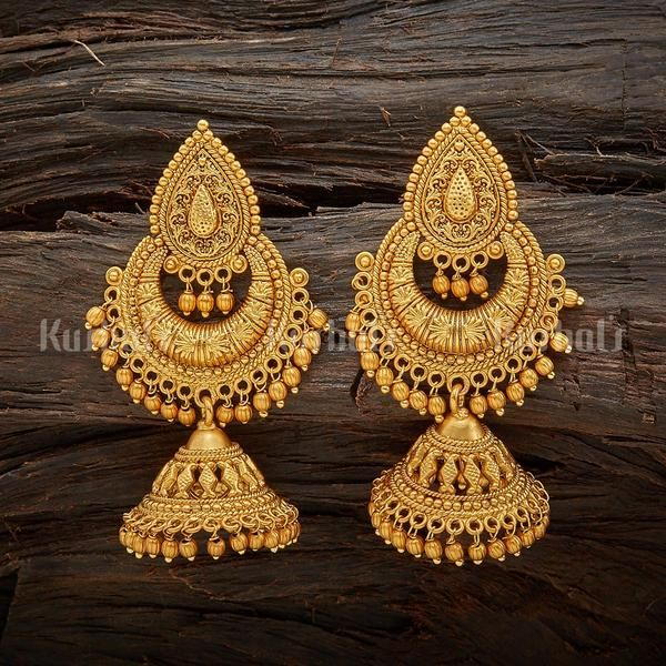 Designer antique jhumka earrings plated with gold polish and made .