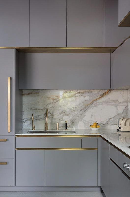 Gold tap in grey metro&urbo Roundhouse kitchen .
