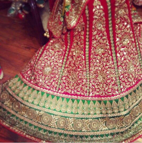 Red lehnga with a green border with gota patti detailing | Gota .