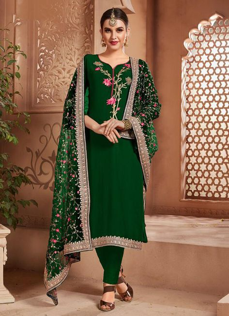 party wear dark green georgette embroidery work churidar suit .