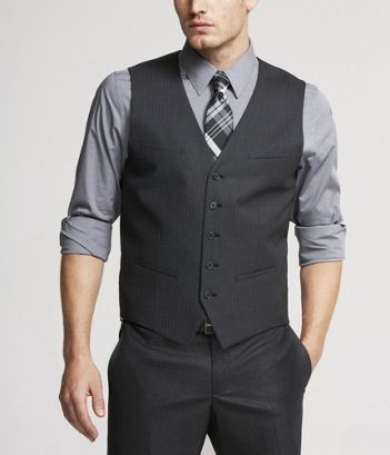 The groomsmen - charcoal pants and vests with a grey shirt (rolled .