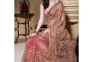 Exclusive latest designer Party Wear Net Bridal Work Saree Peach .