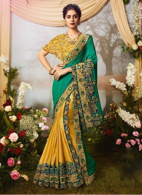 yellow colour gorgeous wedding and party wear silk heavy work .