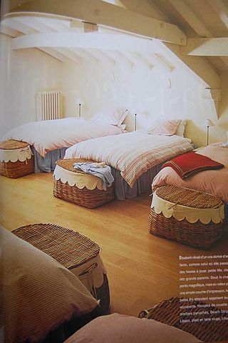 In spare room Have large baskets that hold inflatable bed, pillow .