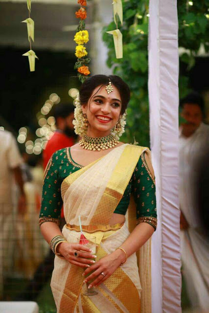 35 Gorgeous Kerala Saree Blouse Designs to try this year .