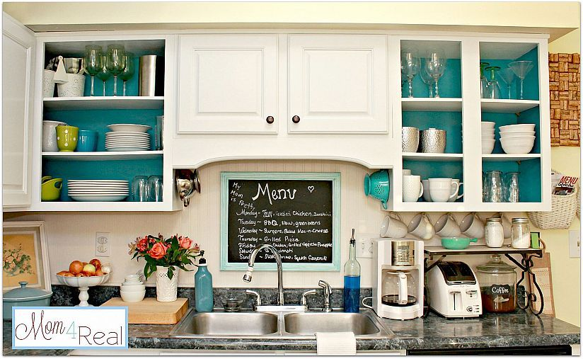 Open Kitchen Cabinets with Aqua, White, Lime Green, and Silver .