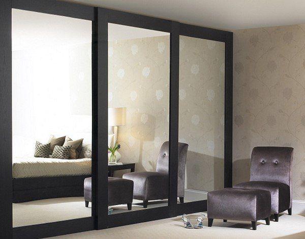 Sliding mirrored closet doors get an updated look installed floor .
