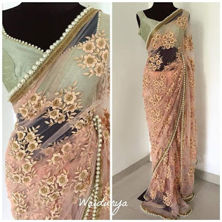 Baby Pink Mono Net Heavy Embroidery Saree with Pearl Border .