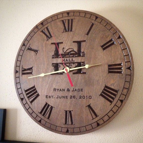 This Family Name Clock is carved on wood and each one is custom .