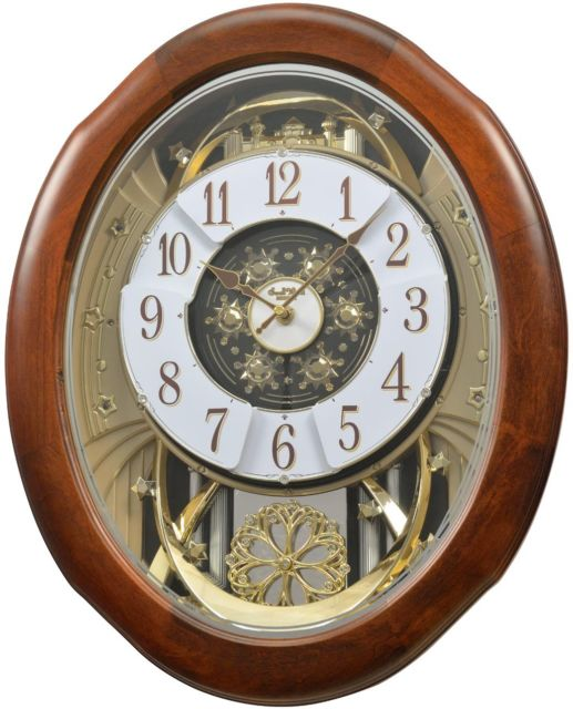 New!) MAGNIFICENT Musical Magic Motion Wall Clock by Rhythm Clocks .