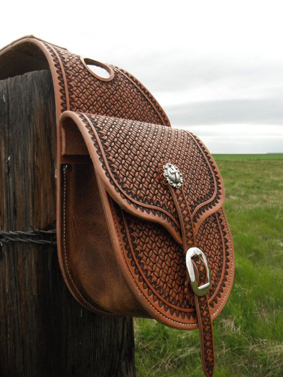 Custom Hamdmade Stamped Leather Saddle Bags. For sale on etsy by .