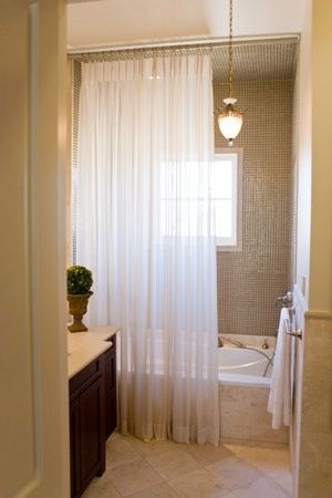 A sheer fabric shower curtain is another way to go (With images .