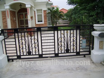 Popular high garde ornamental wrought iron sliding gate design .