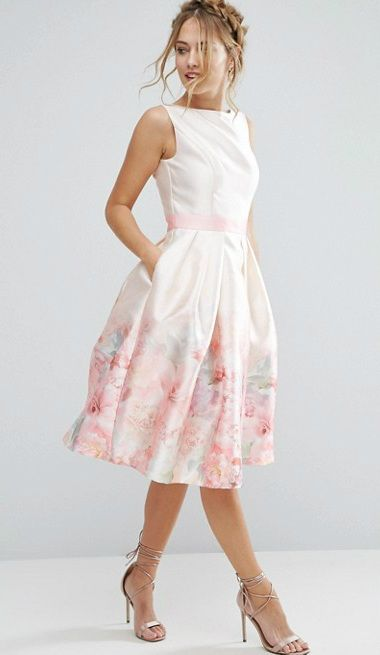 Pale pink dress with pastel floral hem detail. Beautiful dress for .
