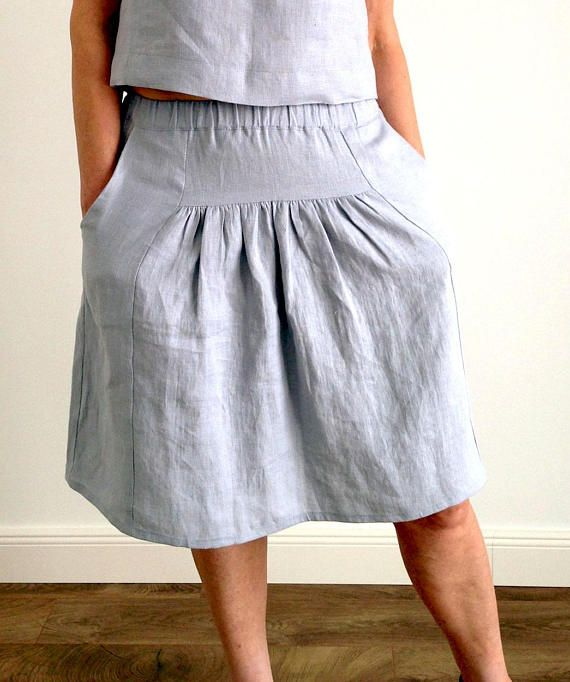 Linen loose midi summer skirt with wide elastic waist pockets .
