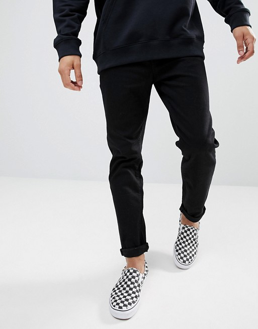 ASOS DESIGN tapered jeans in black | AS