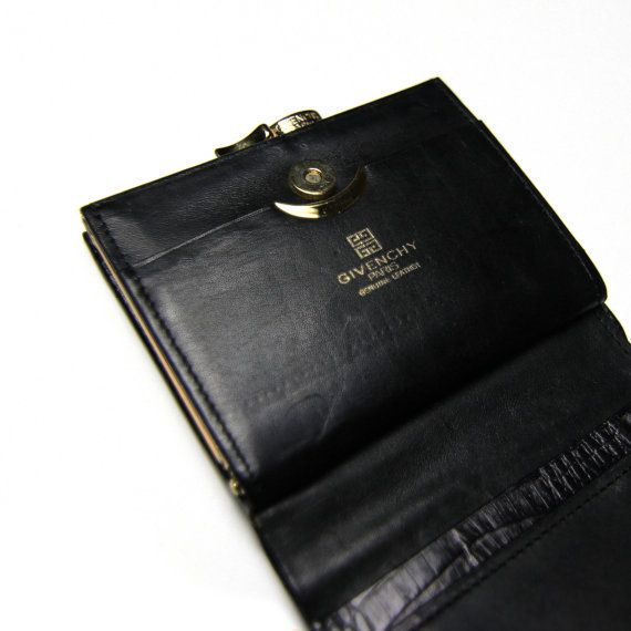 An authentic vintage Givenchy wallet, emulating what Givenchy does .