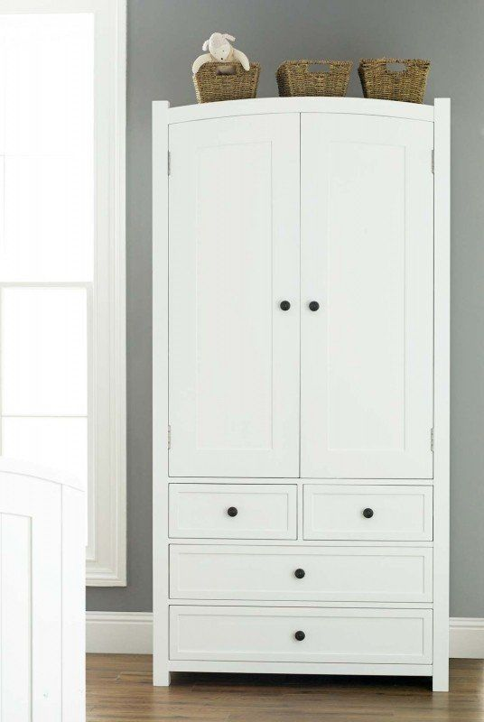 White wardrobe with drawers giving an elegant look .