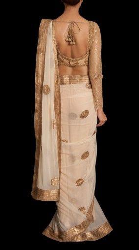 Pretty white and gold saree or sari with blouse. #IndianFashion .