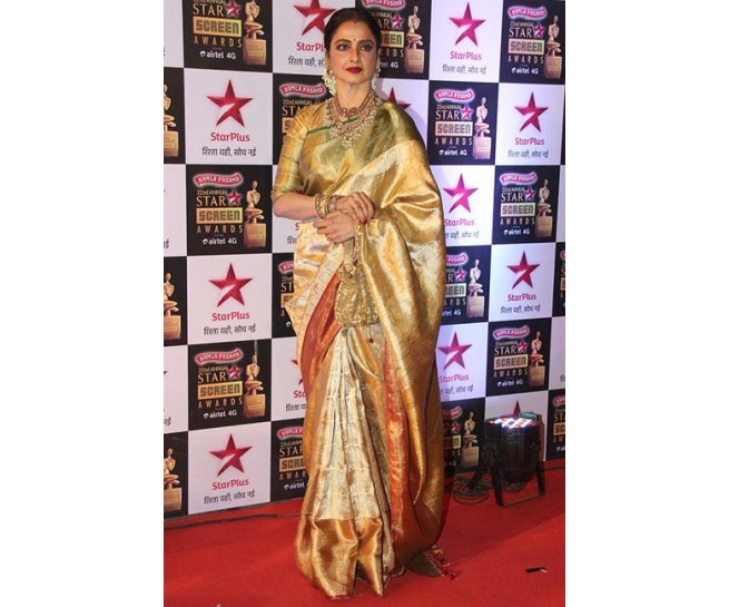 Gold and silver zari wedding silk saree in 6 inches contrast .